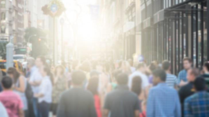People walking down a busy street