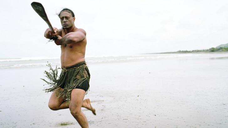 a Māori man performing a pōwhiri