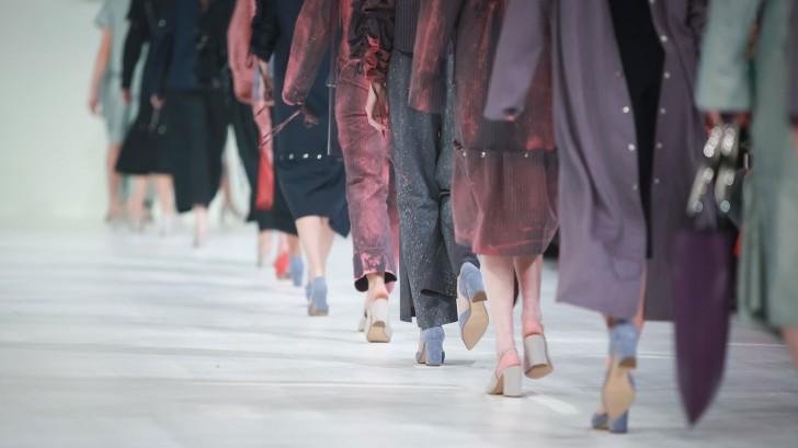 women walking on a catwalk