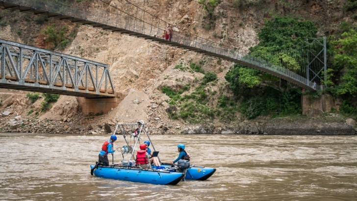tipper and colleagues collect samples from the Koshi River in Nepal
