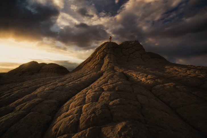Kyle Hague stands on a mountain in the American Southwest