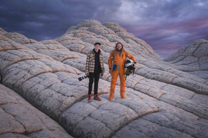 Andrew Studer and Kyle Hague stand on a moon-like mountain in the American Southwest