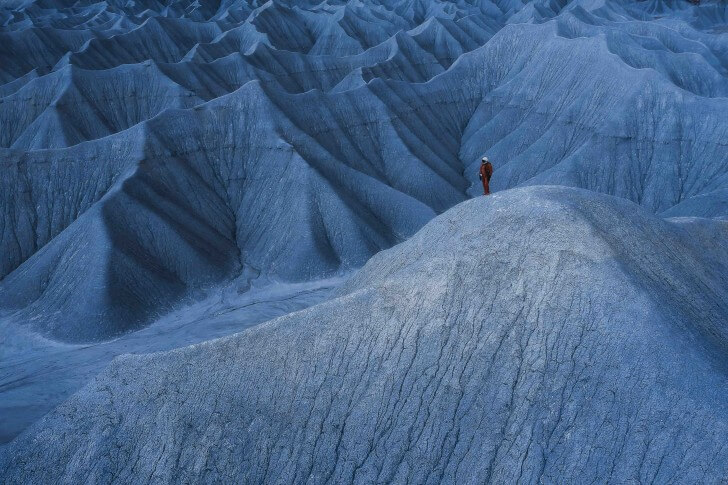 Kyle Hague stands on a moon-like mountain in the American Southwest