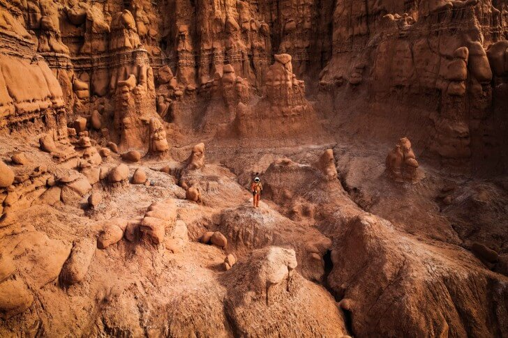 Kyle Hague stands in a rocky area in the American Southwest that resembles Mars