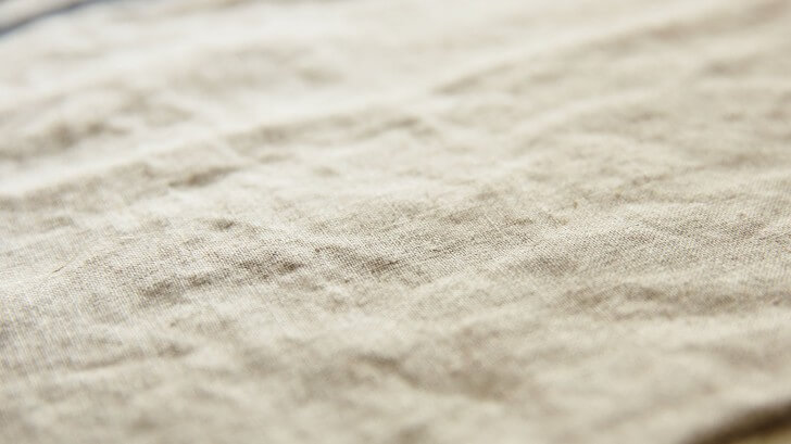 A close up photo of a swathe of white linen