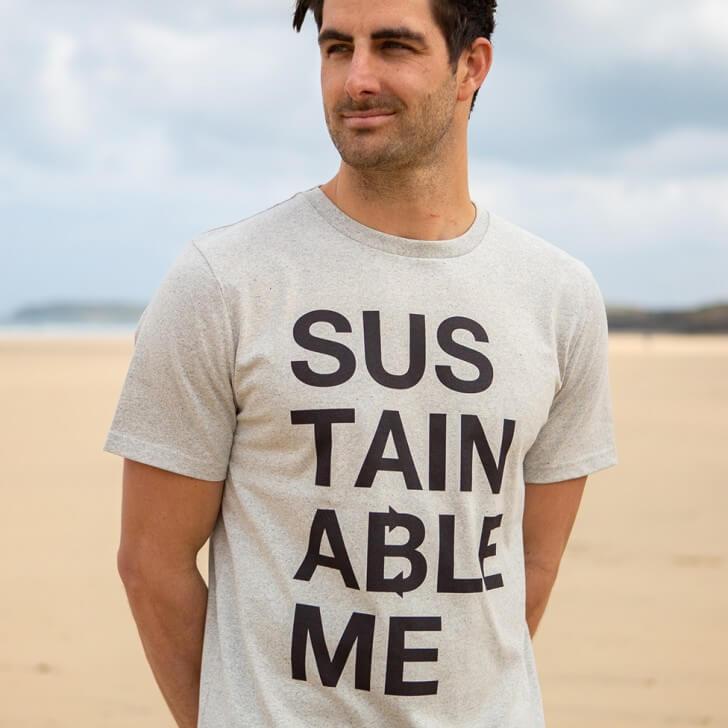 A man on a beach wears a 'circular' t-shirt from Teemill