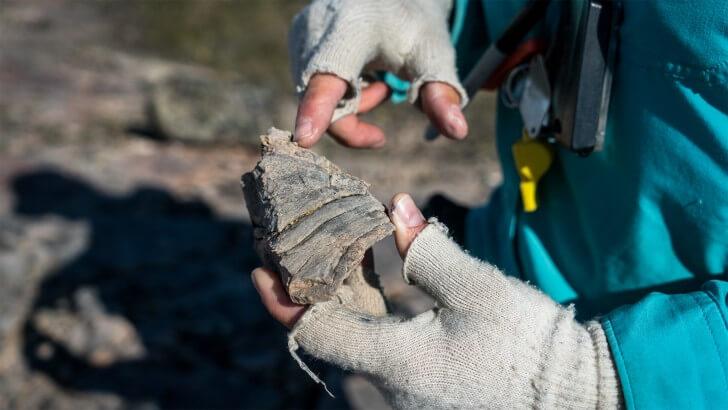 hands holding rock