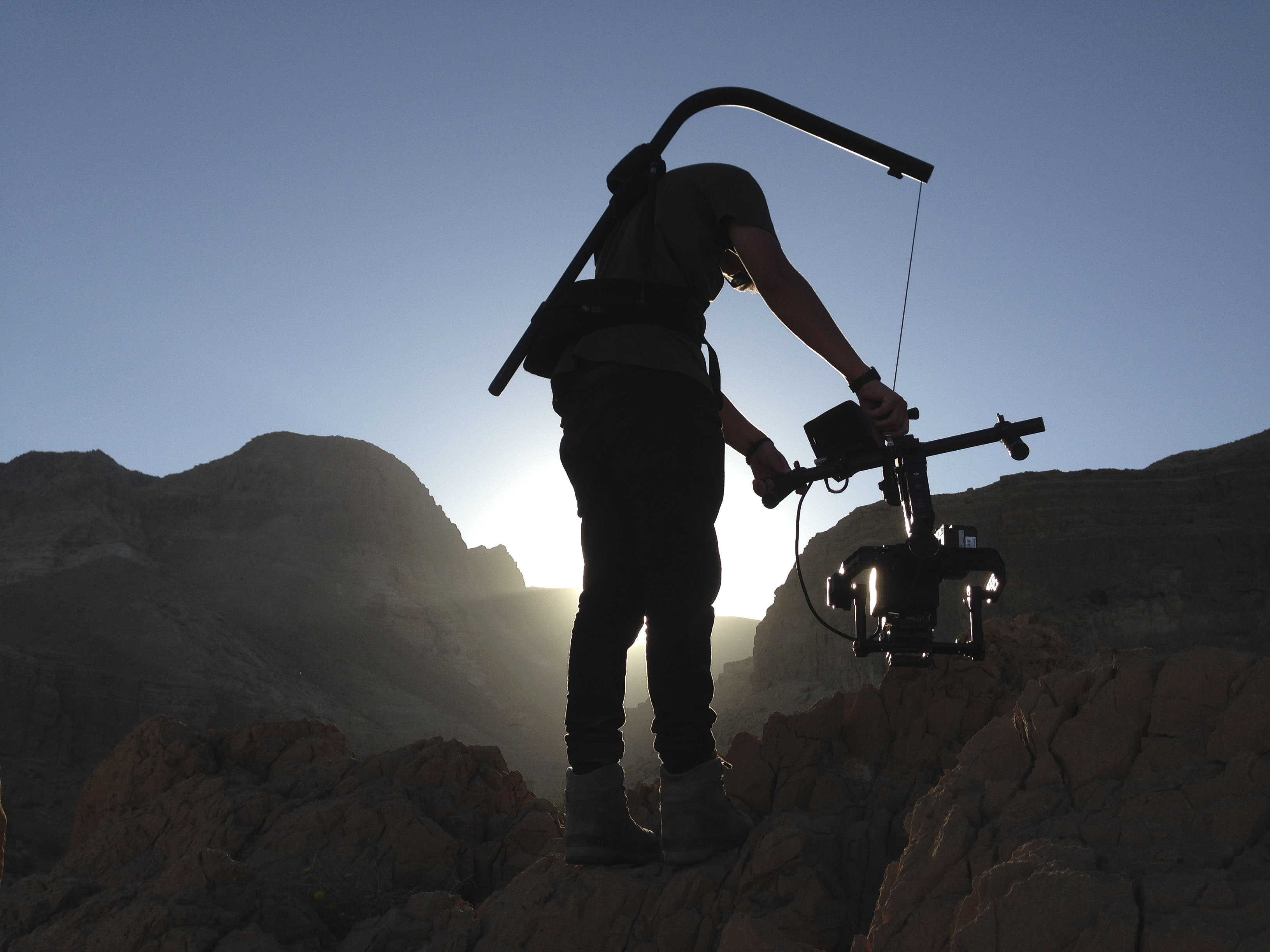 Cameraman filming in the mountains for Planet Earth 2