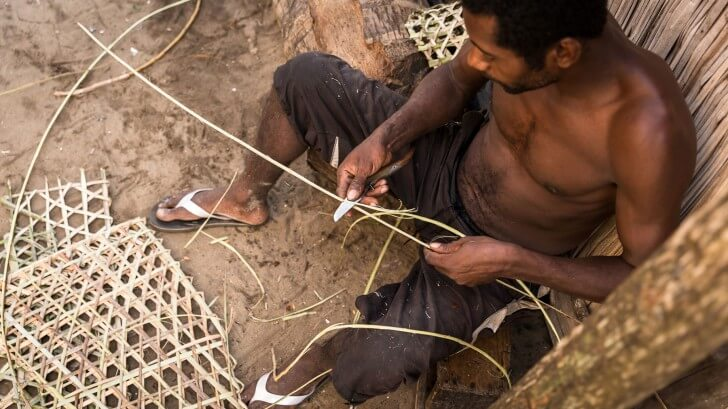 A fisherman called Tsiraiky hand weaves the lobster pots